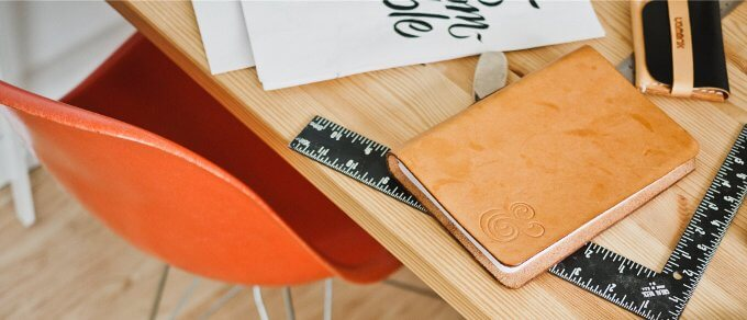 image of orange chair at desk fir notebook